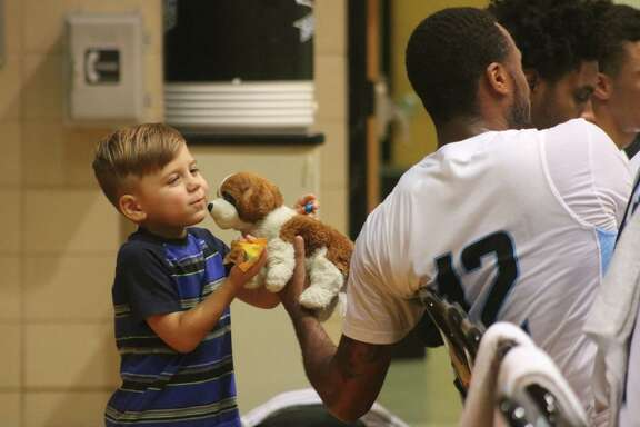In between scoring 14 points for the Ravens, San Jac player Tay Hardy had fun with Bennett Gernander's stuffed animal during the team's contest with Lone Star College-Tomball. Bennett also may have offered the Raven some of his candy. Bennett is head coach Scott R. Gernander's son.
