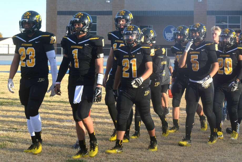 The Petersburg Buffs take the field for their area round playoff game against Follett at White Deer Friday. Photo: Skip Leon/Plainview Herald