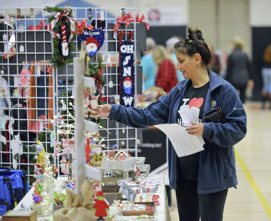 Patty Blasins of Stamford looks at holiday ornaments while she shops during the First Annual Stamford High School Holiday Fair in Stamford, Conn. on Saturday, Nov. 25, 2017. The event featured over 60 vendors, a holiday photo booth, activities for the kids, a seasonal dessert bar featuring Holiday cookies & cupcakes by Tiffany and Holiday Carols performed by the Stamford High School Madrigals. Photo: Matthew Brown / Hearst Connecticut Media / Stamford Advocate