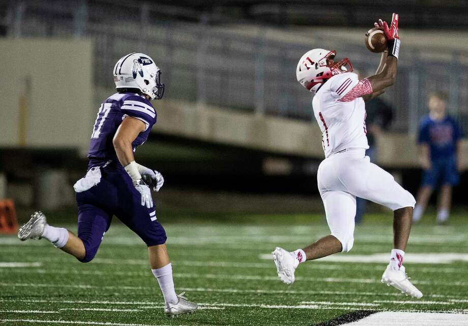 Crosby wide receiver Cedric Patterson III (11) beats Port Neches-Groves defensive back Zane Hernandez (17) for a 91-yard touchdown reception during the first quarter of a Class 5A bi-district playoff football game at Stallworth Stadium on Friday, Nov. 17, 2017, in Baytown. ( Brett Coomer / Houston Chronicle ) Photo: Brett Coomer, Staff / © 2017 Houston Chronicle