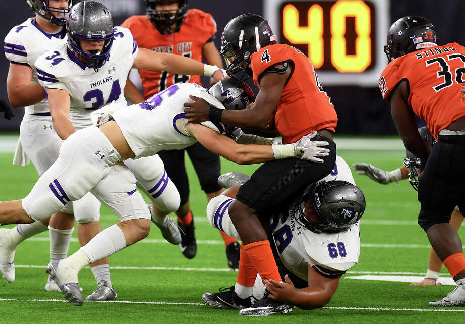 Port Neches-Groves' Preston Hughes takes down a Texas City runner during a play-off game at NRG Stadium Friday. Photo taken Friday, November 24, 2017 Guiseppe Barranco/The Enterprise Photo: Guiseppe Barranco, Photo Editor / Guiseppe Barranco ©