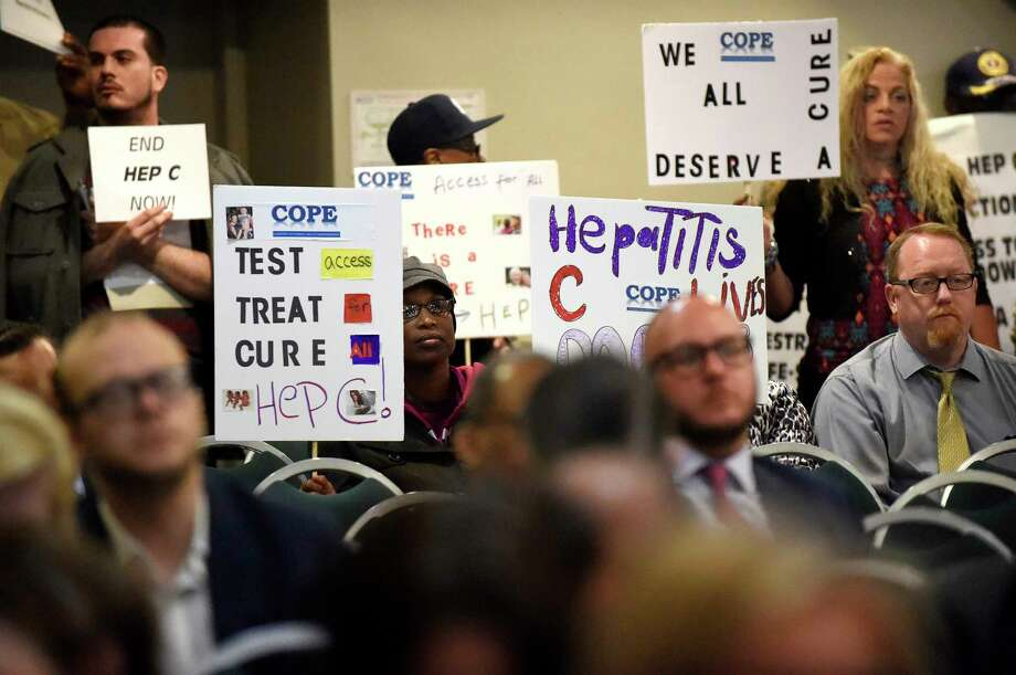 Protesters make their demands known at a New York state health department drug review board in 2016 in Albany, N.Y. The group was calling for unrestricted access to Medicaid treatment for people living with hepatitis C. Photo: Cindy Schultz, Staff Photographer / Albany Times Union
