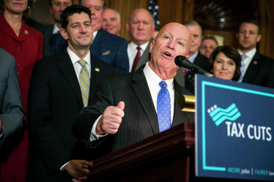 Rep. Kevin Brady (R-Texas), with House Speaker Paul Ryan (R-Wis.) and other House Republicans, speaks during a news conference at the Capitol after the House passed a sweeping rewrite of the tax code on Nov. 16, 2017. (Al Drago/The New York Times) Photo: AL DRAGO, STR / NYTNS