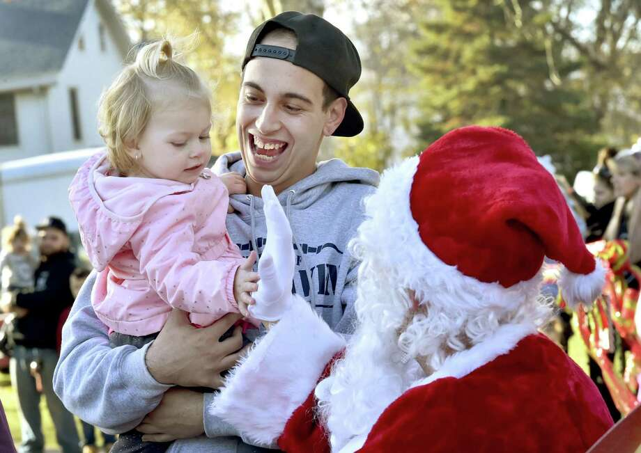 East Haven, Connecticut - Saturday, November 25, 2017: Dylan Goulet of East Haven and his daughter Ava Goulet, 18-months, enjoy a visit with Santa during the East Haven Chamber of Commerce Christmas holiday festivities Saturday on the East Haven Green as a prelude to the tree lighting ceremony on the town green. Photo: Peter Hvizdak / Hearst Connecticut Media / New Haven Register