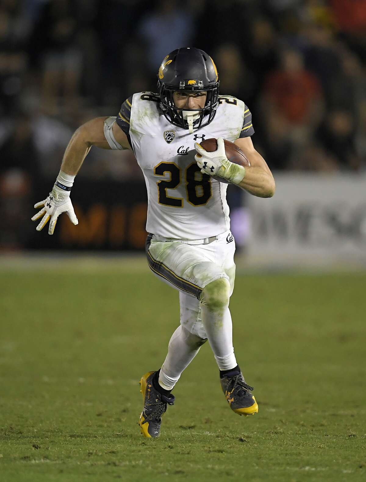 California running back Patrick Laird runs the ball during the second half of an NCAA college football game against UCLA, Friday, Nov. 24, 2017, in Los Angeles. UCLA won 30-27. (AP Photo/Mark J. Terrill)