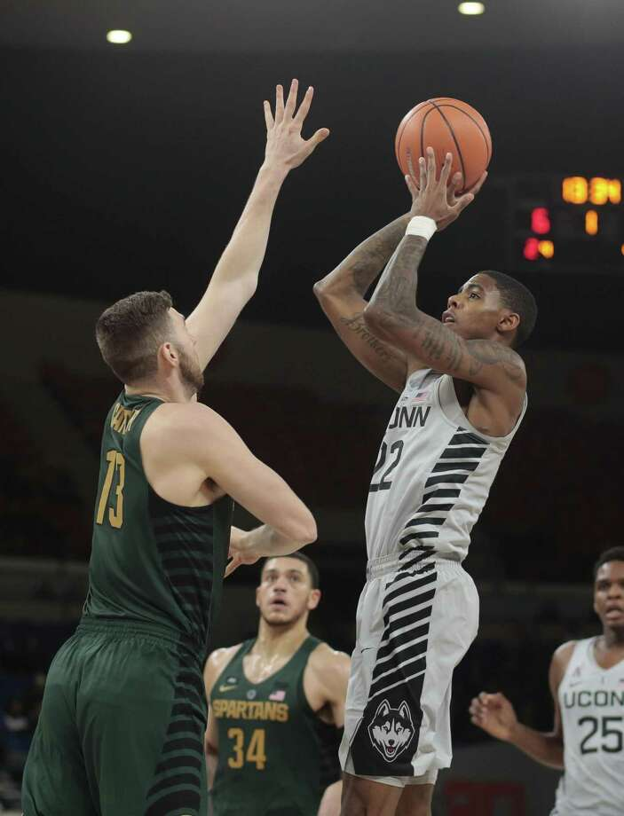 UConn's Terry Larrier (22) shoots over Michigan State's Ben Carter during the first half of Friday's contest. Photo: Timothy J. Gonzelez / Associated Press / © 2017 Associated Press / All Rights Reserved