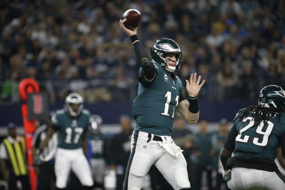 Eagles quarterback Carson Wentz throws against the Cowboys last Sunday. Photo: Ron Jenkins / Associated Press / FR171331 AP