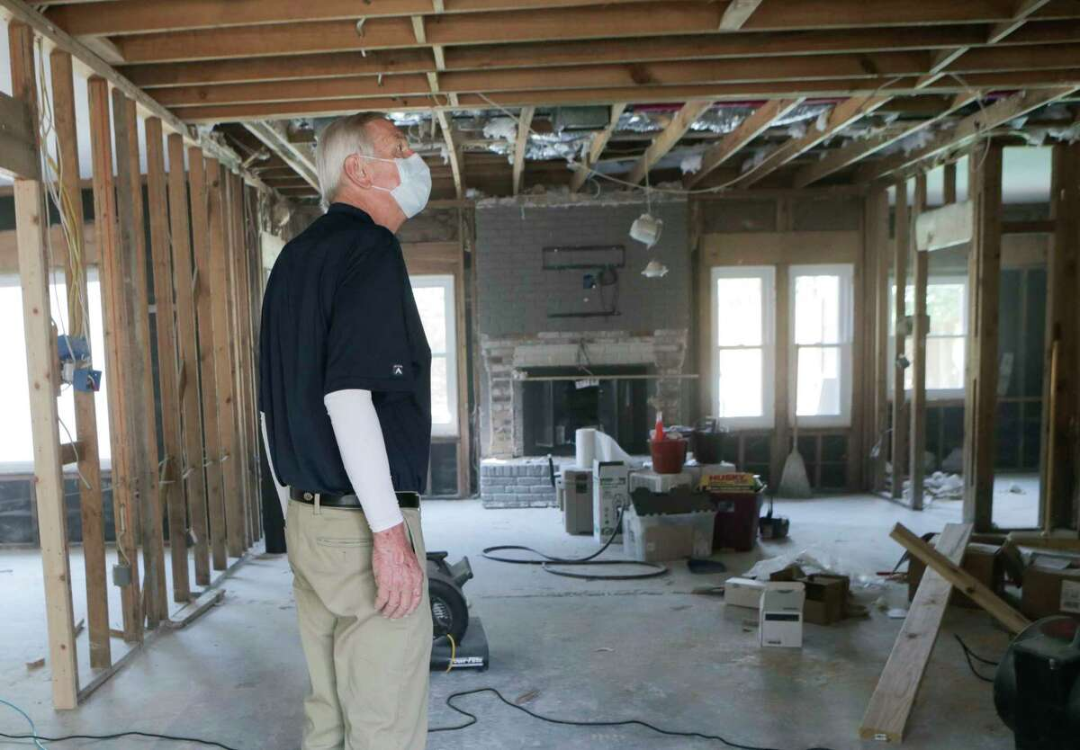 Ken Akre, a recent heart transplant recipient, looks at the damage of his daughter's home on Tuesday, Nov. 14, 2017, in Houston. ( Elizabeth Conley / Houston Chronicle )