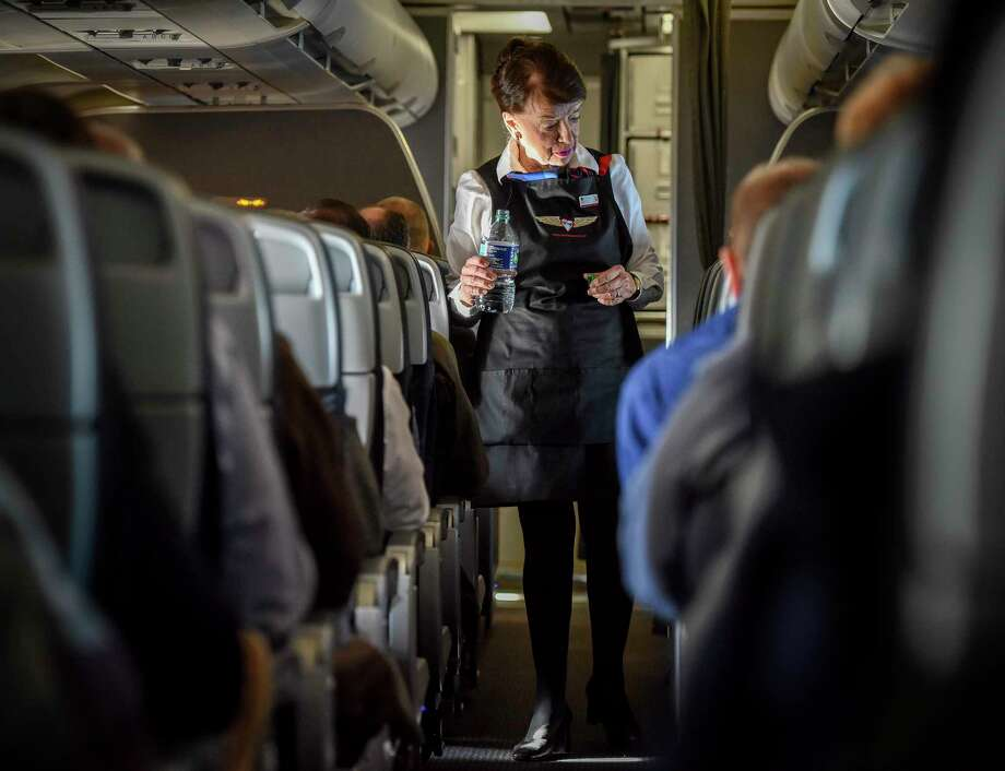 "Bette Nash, checking on her American Airlines passengers this month, still brings the people on her flight ""a little love and a little attention."" Must credit: Washington Post photo by Bill O'Leary Photo: Bill O'Leary, The Washington Post / The Washington Post"
