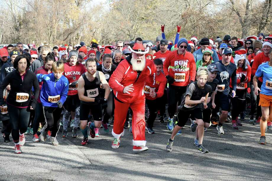 Bill Buckbee, aka Santa, starts with the field of the 5k during the Run Santa Run 5k Run, Walk and Kids Fun Run at Harrybrooke Park in New Milford, Saturday, Nov. 25, 2017. Funds raised this year will be donated to the park and the Juvenile Diabetes Research. Photo: Krista Benson / The News-Times Freelance