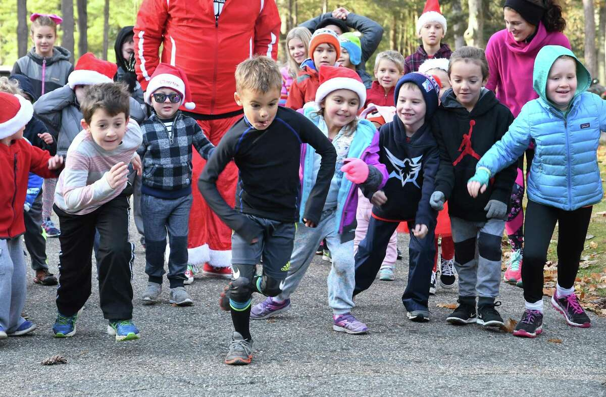 The six and under kids start their fun run at the Run Santa Run 5k Run, Walk and Kids Fun Run at Harrybrooke Park in New Milford, Saturday, Nov. 25, 2017. Funds raised this year will be donated to the park and the Juvenile Diabetes Research.