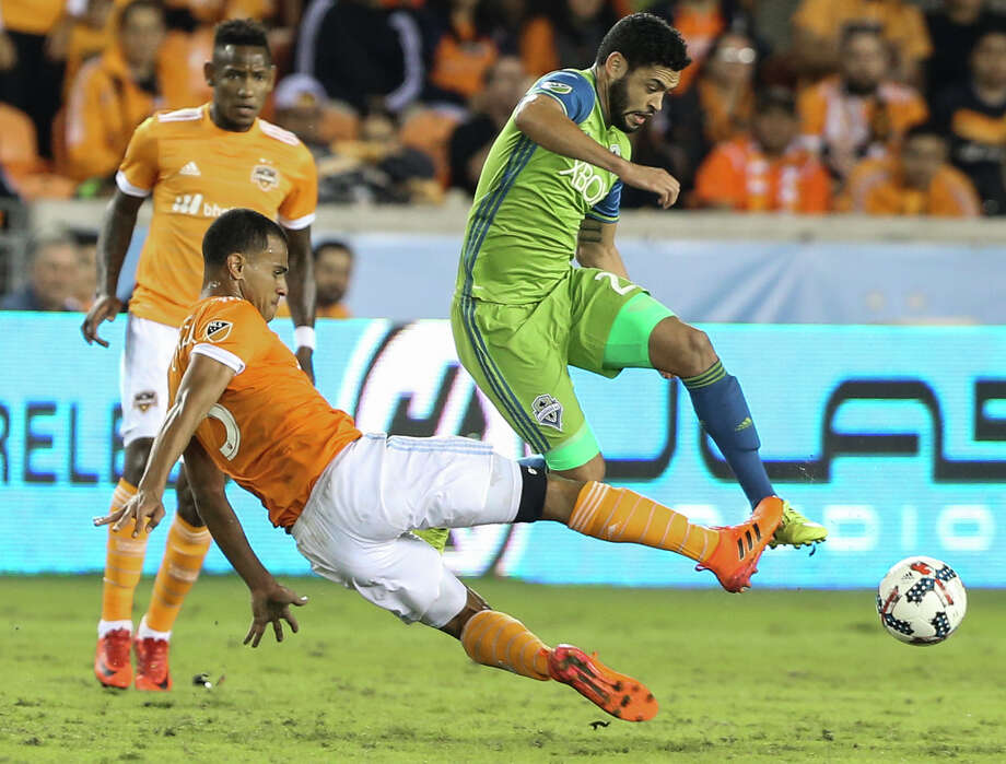 Dynamo midfielder Juan David Cabezas, left, made 27 appearances during the regular season and has played every minute of the club's four games in the MLS playoffs. Photo: Yi-Chin Lee, Houston Chronicle / © 2017  Houston Chronicle