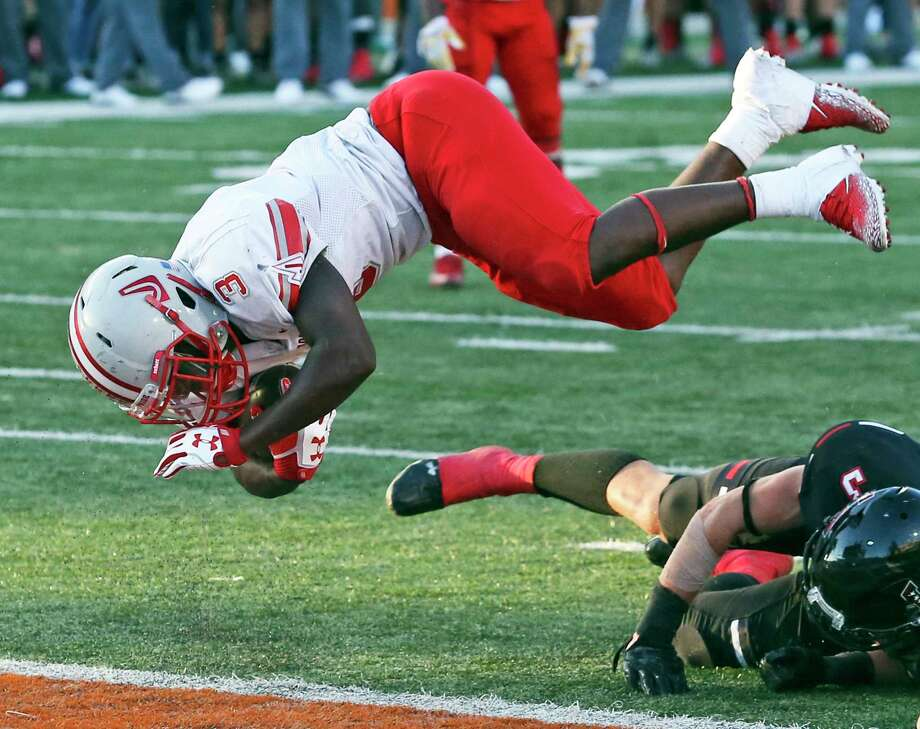 Sincere McCormick flies into the end zone for a third quarter Rockets touchdown as Judson plays Lake Travis in second round playoff action at DKR Stadium in Austin on November 25, 2017 Photo: Tom Reel, San Antonio Express-News / 2017 SAN ANTONIO EXPRESS-NEWS