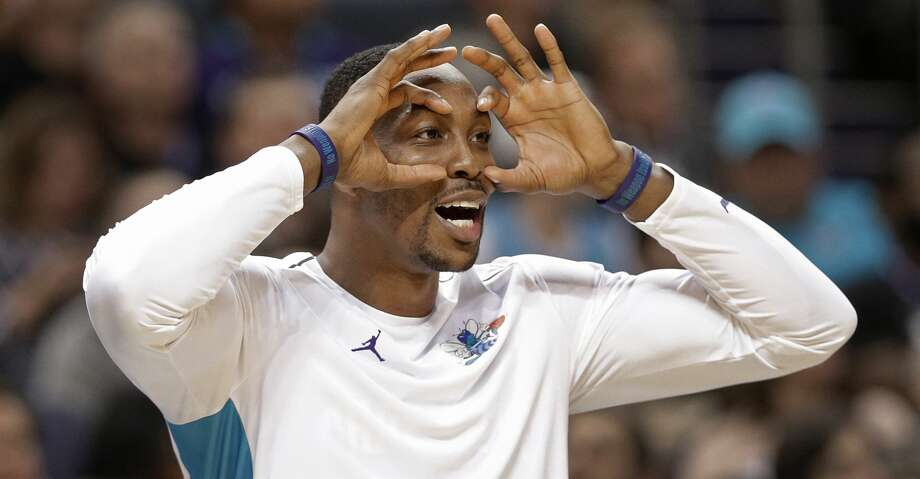 Hornets center Dwight Howard was fined $35,000 for an obscene gesture he made toward Cavaliers fans during the second quarter of Charlotte's 100-99 loss to Cleveland on Friday. Photo: Chuck Burton/Associated Press