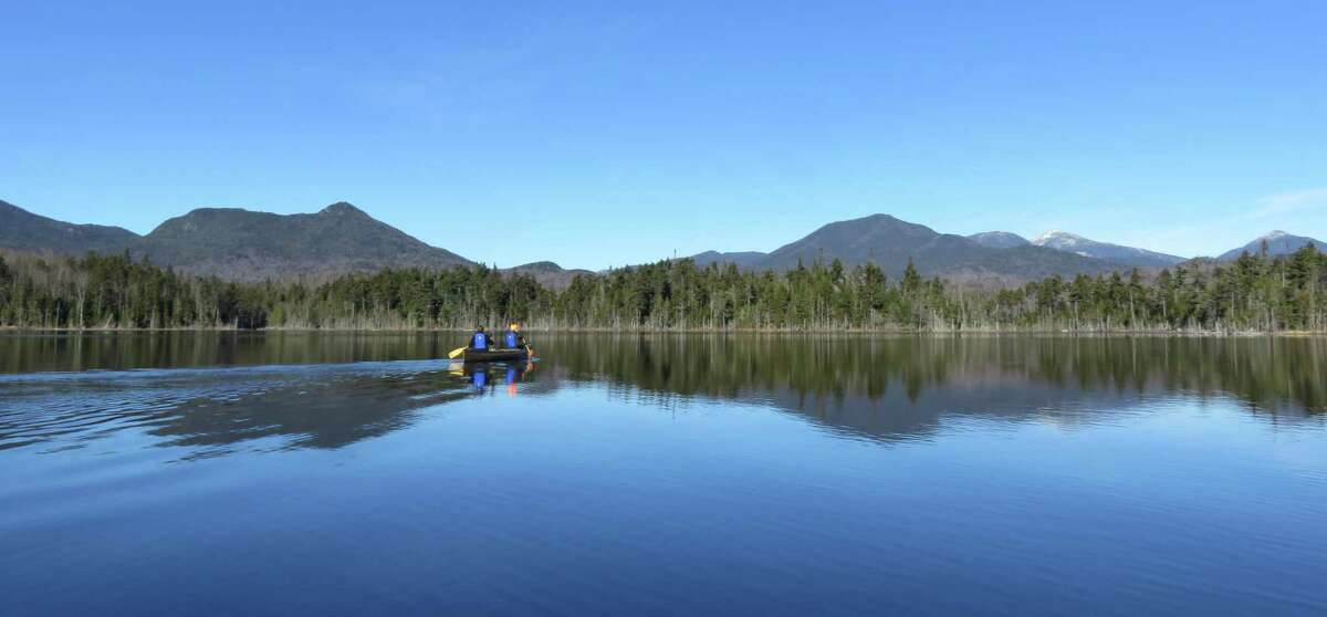 The Boreas Ponds offer some idyllic paddling and fantastic views of the Adirondack High Peaks, including, to the right, Allen, Marcy, Skylight and Haystack. Cheney Cobble is to the right. (Gillian Scott / Special to the Times Union)