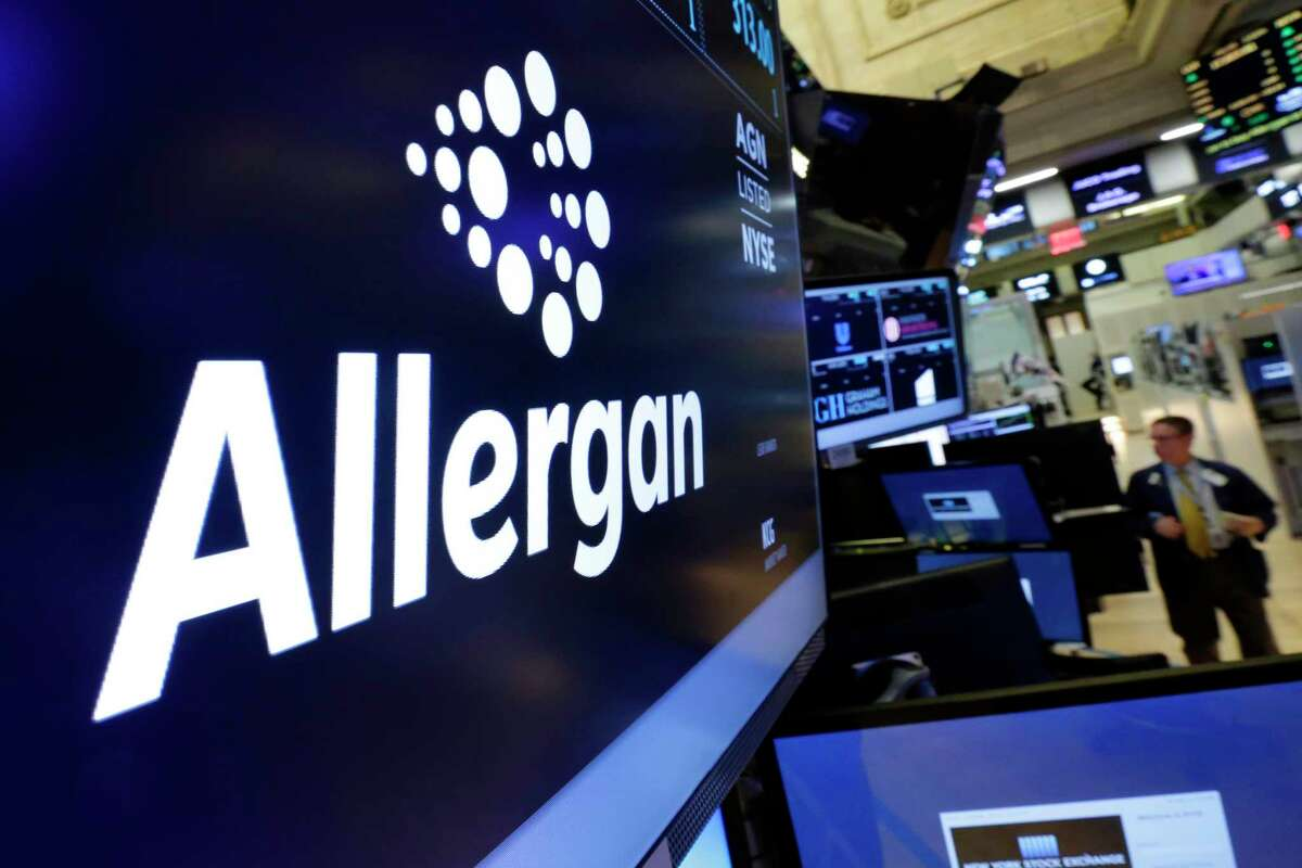 FILE - In this Monday, Nov. 23, 2015, file photo, the Allergan logo appears above a trading post on the floor of the New York Stock Exchange. Pfizer and Allergan are joining in one of the biggest buyouts of the year, a $160 billion stock deal that will create the world's largest drugmaker. Companies around the world spent a record $4.93 trillion on acquisitions in 2015, according to Dealogic, as slow worldwide economic growth and low interest rates pushed companies to combine forces. (AP Photo/Richard Drew, File) ORG XMIT: NYBZ202
