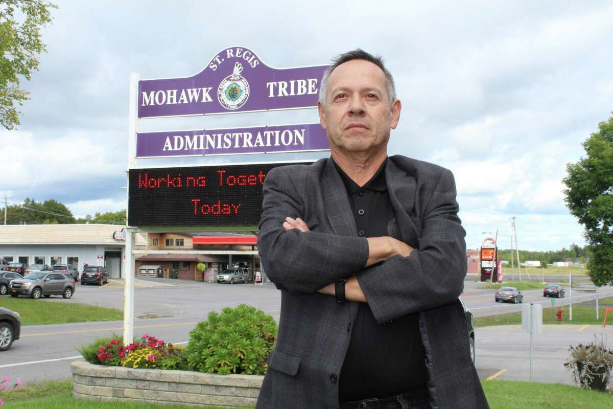 Dale White, general counsel of the Saint Regis Mohawk Tribe, stands outside tribal headquarters. The tribe shook up the pharmaceutical industry and federal lawmakers by taking patent rights for a multibillion-dollar eye medication.
