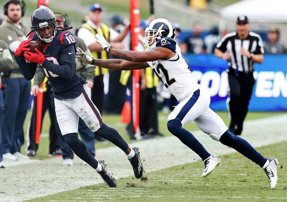 Houston Texans wide receiver DeAndre Hopkins (10) makes a first down reception against Los Angeles Rams cornerback Trumaine Johnson (22) during the third quarter of an NFL football game at the Los Angeles Memorial Coliseum on Sunday, Nov. 12, 2017, in Los Angeles, Mass. ( Brett Coomer / Houston Chronicle ) Photo: Brett Coomer, Staff / © 2017 Houston Chronicle