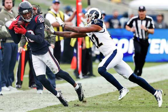 Houston Texans wide receiver DeAndre Hopkins (10) makes a first down reception against Los Angeles Rams cornerback Trumaine Johnson (22) during the third quarter of an NFL football game at the Los Angeles Memorial Coliseum on Sunday, Nov. 12, 2017, in Los Angeles, Mass. ( Brett Coomer / Houston Chronicle )