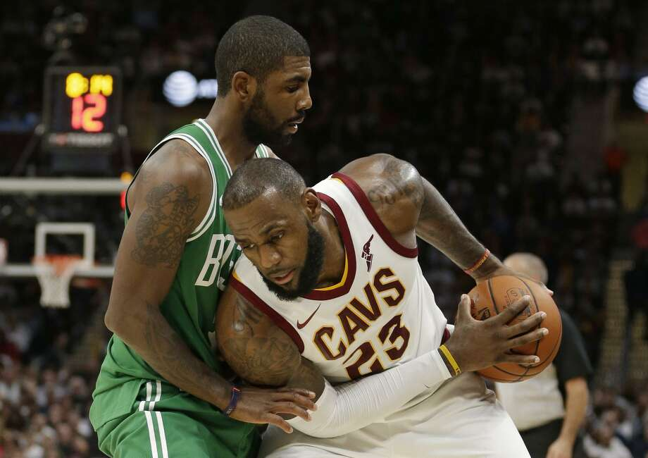 LeBron James (right) drives on Kyrie Irving, who has seen his scoring average drop by 2.3 per game since moving to Boston. Photo: Tony Dejak / Tony Dejak / AP / AP 2017