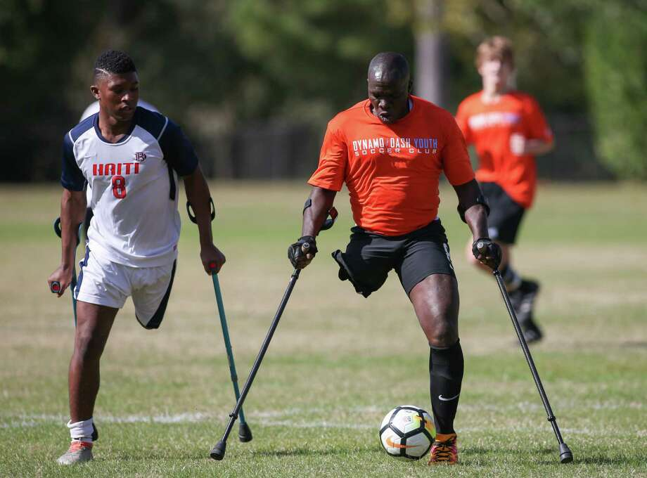Players use crutches for balance in the Texas Regional Amputee Soccer exhibition match between the Haitian National Amputee Soccer Team and Lone Star Amputee Soccer Houston team at Lents Family Park. The Americans beat the ranked Haitians, 6-3. Photo: Leslie Plaza Johnson, Freelancer / Freelance