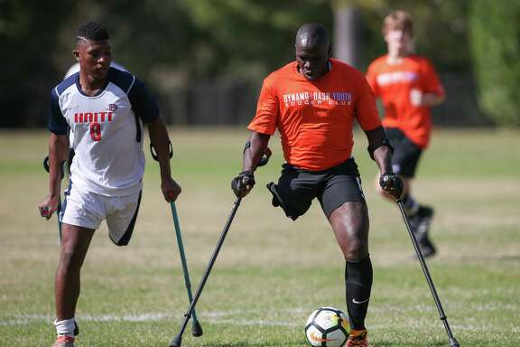 Players use crutches for balance in the Texas Regional Amputee Soccer exhibition match between the Haitian National Amputee Soccer Team and Lone Star Amputee Soccer Houston team at Lents Family Park. The Americans beat the ranked Haitians, 6-3.