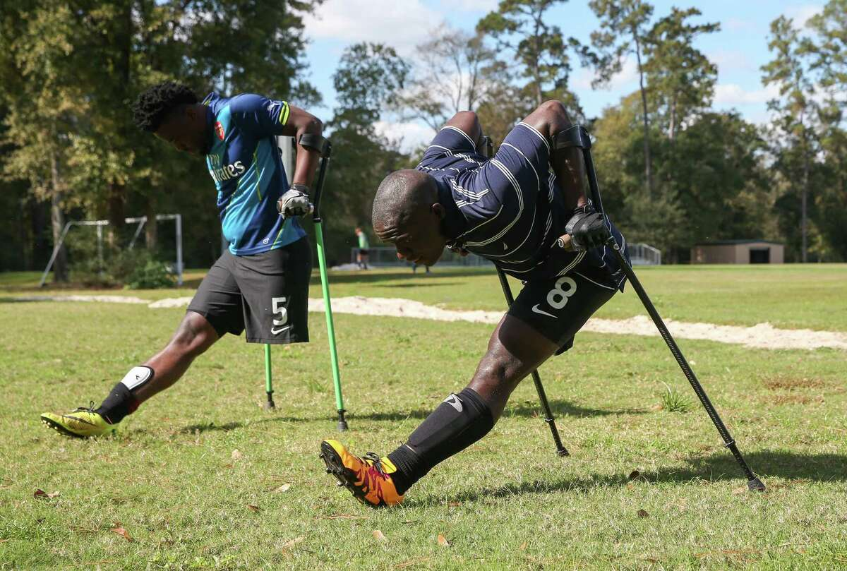 Members of the Haitian National Amputee Soccer Team warm up before an exhibition match at Lents Family Park. During games, players are not allowed to wear prosthetics or to touch the ball with their crutches.