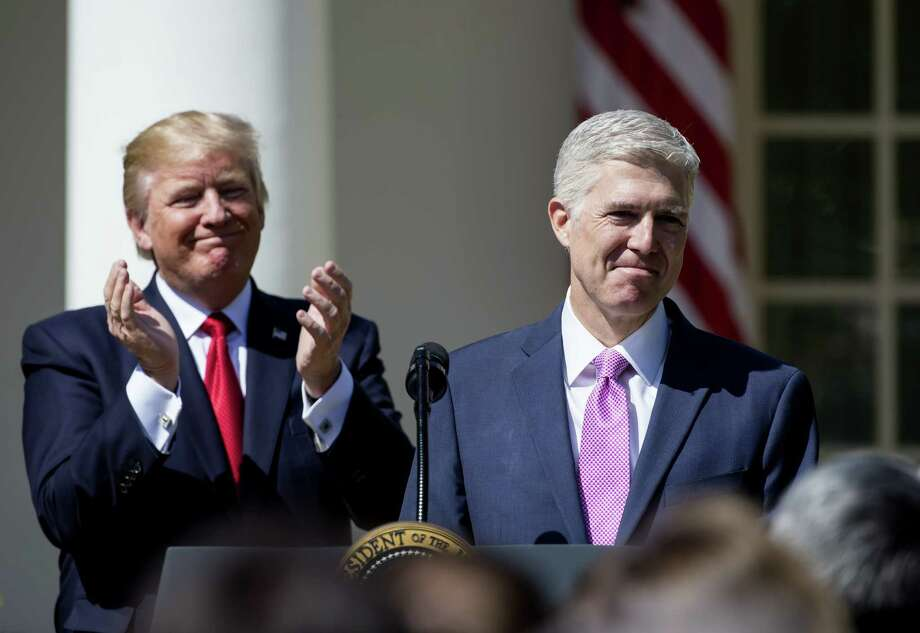 President Donald Trump has filled many judicial seats in just 10 months, including the confirmation of Neil Gorsuch to the U.S. Supreme Court. His picks have been predominantly white, male and conservative.  Photo: Eric Thayer, Stringer / 2017 Getty Images