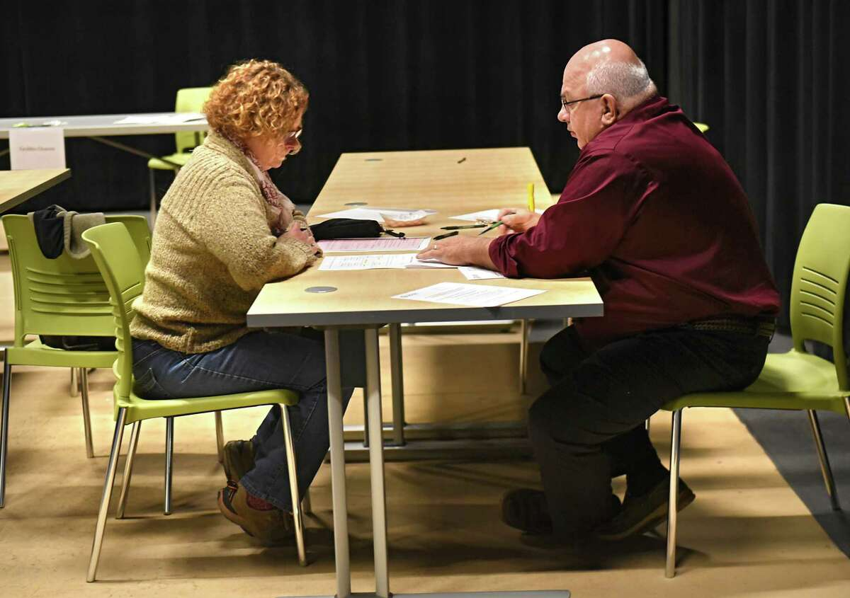 Dee Lowman of Rotterdam, left, fills out paper work with the help of Ken Ziegler, substitute coordinator for Capital Region Boces, at the Center for Advanced Technology on Wednesday, Nov. 15, 2017 in Schenectady, N.Y. Mohonasen Central School District is responding to a state-wide substitute shortage by hosting a Substitute Job Fair for various jobs. (Lori Van Buren / Times Union)