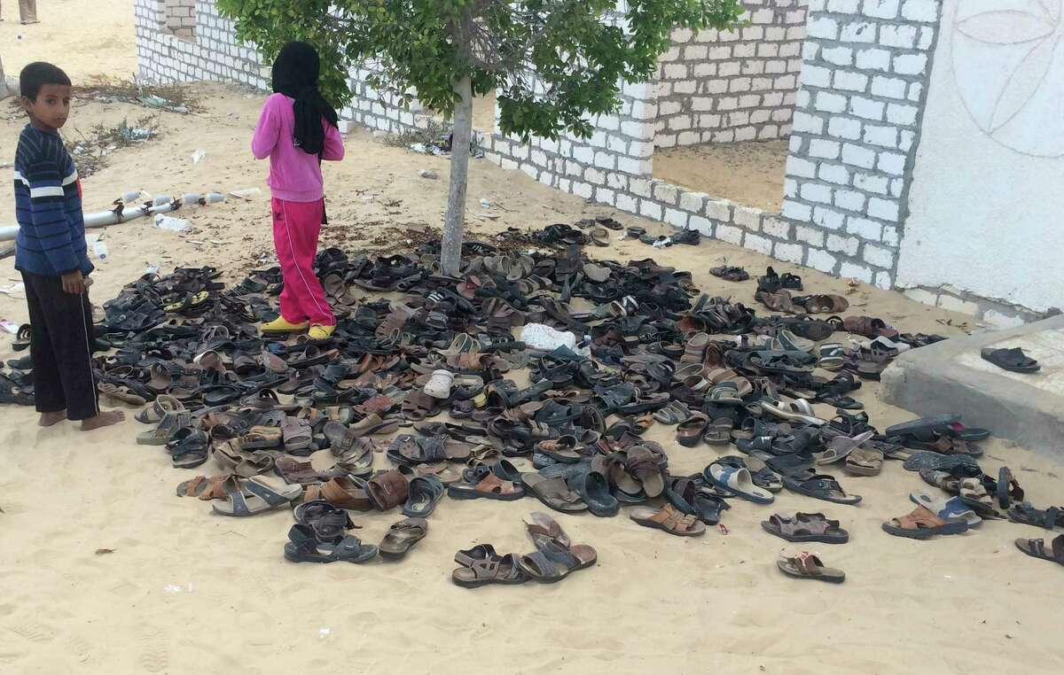 Discarded shoes of victims remain outside Al-Rawda Mosque in Bir al-Abd northern Sinai, Egypt. a day after attackers killed hundreds of worshippers, on Saturday, Nov. 25, 2017. Friday's assault was Egypt's deadliest attack by Islamic extremists in the country's modern history, a grim milestone in a long-running fight against an insurgency led by a local affiliate of the Islamic State group.(AP Photo) ORG XMIT: CAIMA101