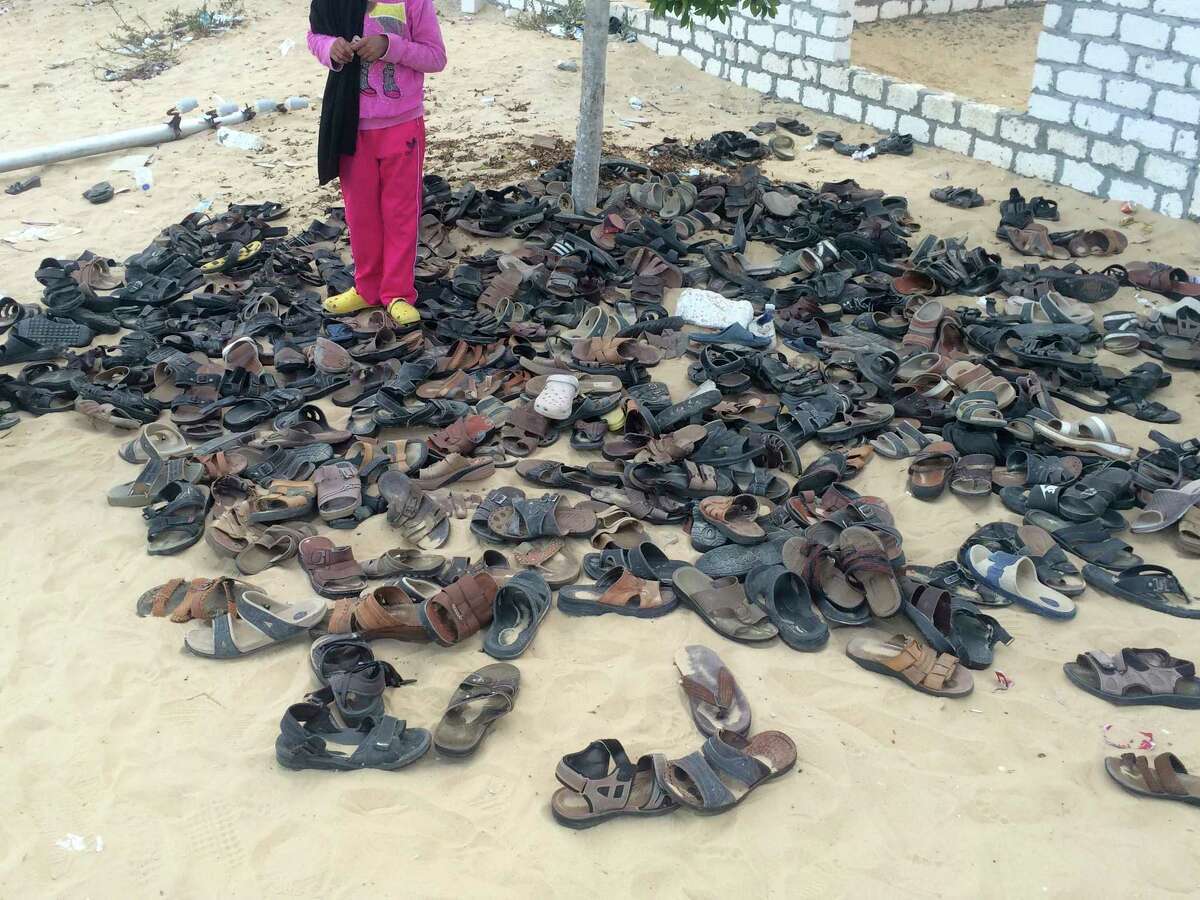 Discarded shoes of victims remain outside Al-Rawda Mosque in Bir al-Abd northern Sinai, Egypt. a day after attackers killed hundreds of worshippers, on Saturday, Nov. 25, 2017. Friday's assault was Egypt's deadliest attack by Islamic extremists in the country's modern history, a grim milestone in a long-running fight against an insurgency led by a local affiliate of the Islamic State group.(AP Photo) ORG XMIT: CAIMA102