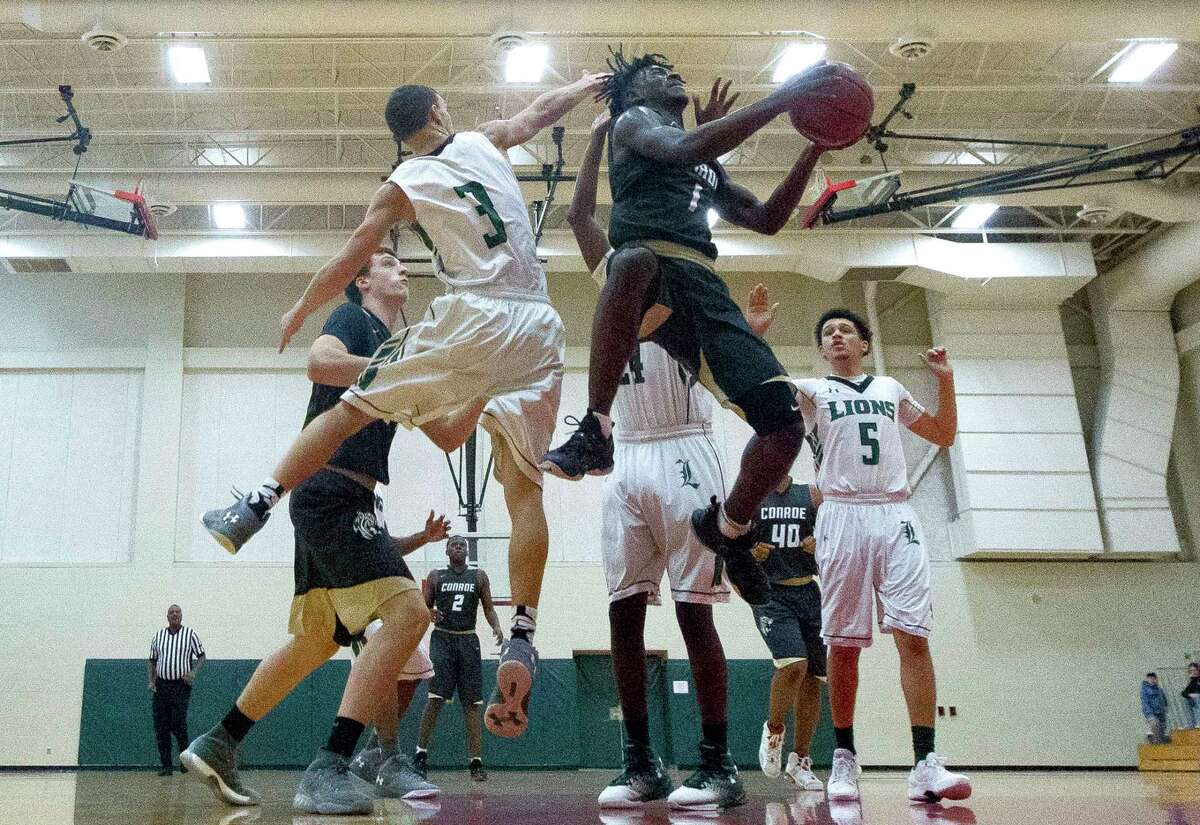 Conroe guard Jay Lewis (1) goes up for a shot under pressure during the second quarter of a high school basketball game in the 2017 Vype Classic at The Woodlands High School, Saturday, Nov. 25, 2017, in The Woodlands.