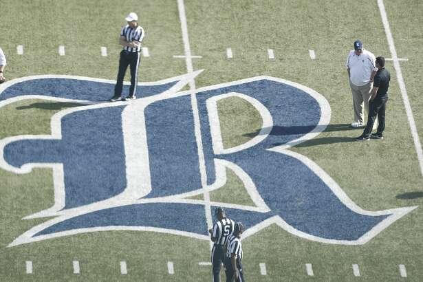Rice Owls head coach David Bailiff, upper right, talks with North Texas Mean Green head coach Seth Littrell, during warmups before a college football game at Rice Stadium, Saturday, Nov. 25, 2017, in Houston.  ( Karen Warren / Houston Chronicle )
