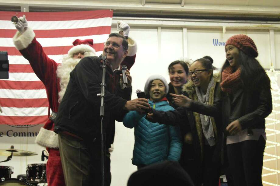 Mayor Ed O'Brien counts down annual tree lighting with Santa and Christmas card design winners from Bailey Middle School, seventh-graders Jasmin Cintron and Llianay Romaro and eighth-graders Eveleen Jiang and Sofia Lora. Photo: Clare Dignan / Connecticut Hearst Media