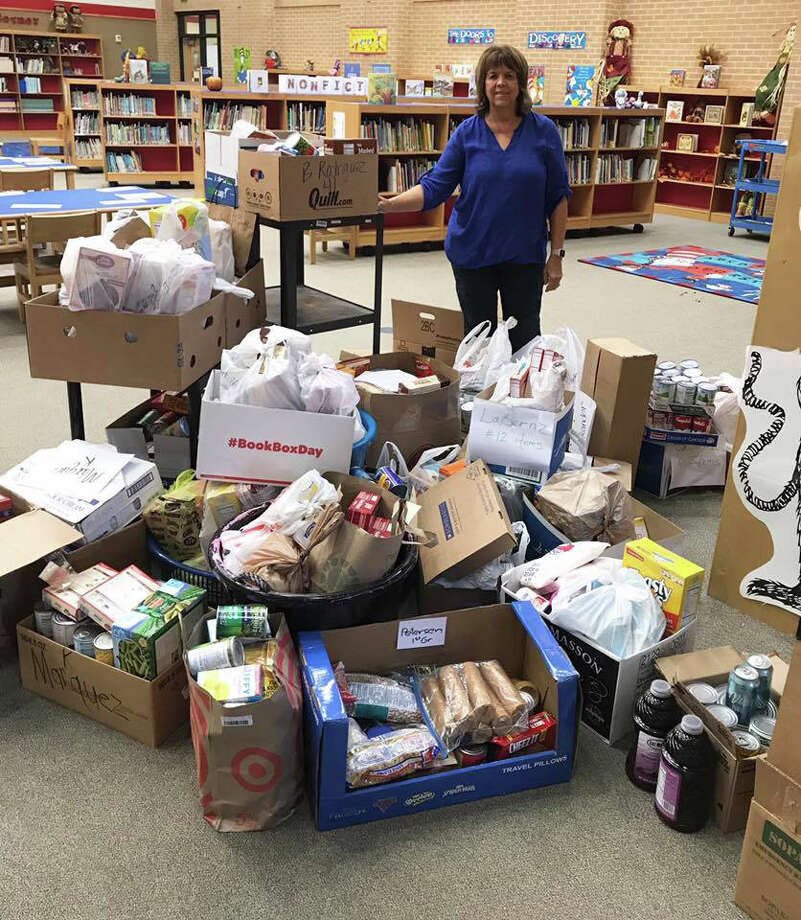 Southside Primary sponsored a food drive recently for Operation Refuge Food Pantry. Pictured is Frieda White, founder of Operation Refuge and co-pastor of Liberty Church of Cleveland. White said this was the tenth year the school hosted a food drive to benefit the food pantry. Photo: Courtesy Photo