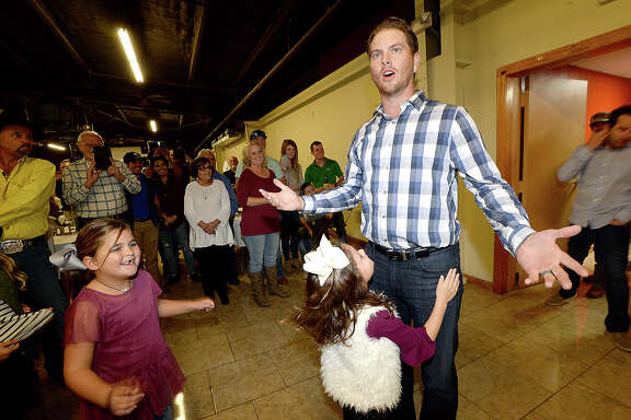 Local pro golfer Chris Stroud reacts as he is greeted by a room full of family, friends and fans who gathered at the Rockin' A Cafe for a surprise party to celebrate his PGA tournament win. The Barracuda trophy and other memorabilia from his 2017 winning season were on display for the party.   Photo taken Saturday, November 25, 2017 Kim Brent/The Enterprise