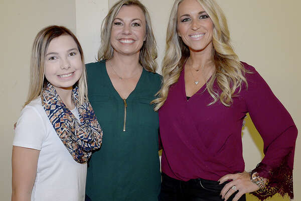 Korin and Laila Beverly and Brie Hebert were at the surprise party in honor of local golfer Chris Stroud's PGA tournament win. Friends, family and fans gathered at the Rockin' A Cafe for the event and had the chance to view the trophy and other memorabilia from his 2017 winning season. Photo taken Saturday, November 25, 2017 Kim Brent/The Enterprise