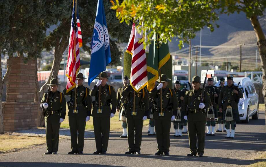 U.S. Border Patrol Agents are seen at the funeral service for fellow Border Patrol Agent Rogelio Martinez at Restlawn Cemetery, Saturday, November 25, 2017, in El Paso, Texas. Martinez, who is an El Paso native, was killed in the line of duty Sunday near Van Horn. Photo by Ivan Pierre Aguirre for San Antonio Express-News Photo: Ivan Pierre Aguirre