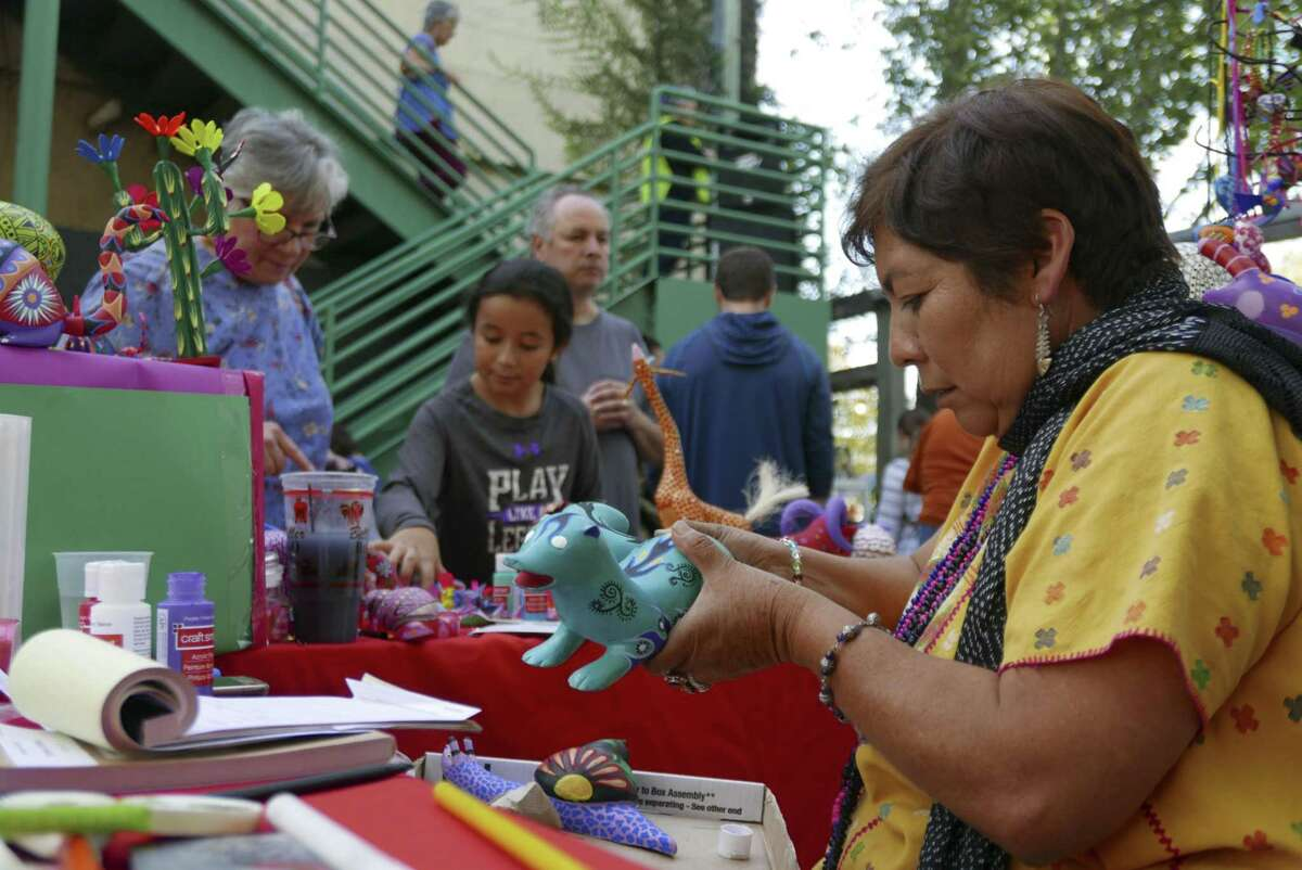 Cristina Antonio Herrera, who is from the municipality of Arrazolaxoxo in the Mexican state of Oaxaca, paints an alebrije, a kind of fantasy creature, at the annual International Peace Market at the Esperanza Peace & Justice Center.