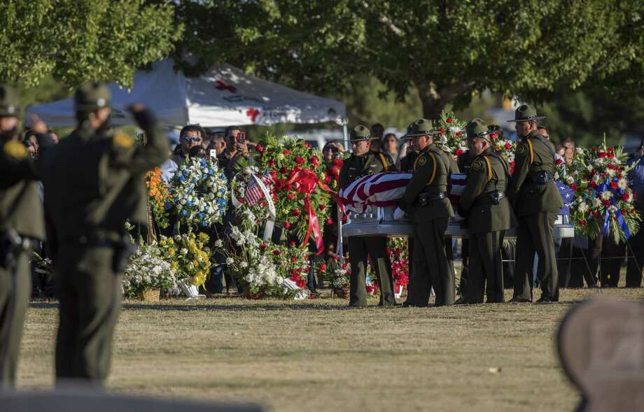 U.S. Border Patrol Agents carry the body of fellow Border Patrol Agent Rogelio Martinez to his gravesite at Restlawn Cemetery, Saturday, November 25, 2017, in El Paso, Texas. Martinez, who is an El Paso native, was killed in the line of duty Sunday near Van Horn. Photo by Ivan Pierre Aguirre for San Antonio Express-News Photo: Ivan Pierre Aguirre, Freelance Photographer / Ivan Pierre Aguirre / Ivan Pierre Aguirre ivan.pierre.aguirre@gmail.com 915.256.2066 EDITORIAL USE ONLY