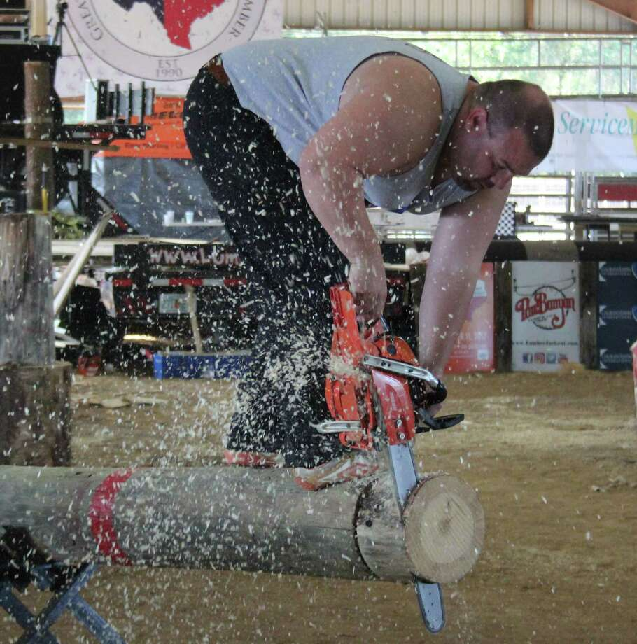 Lumberjacks compete in the hot saw competition during the Texas Lumberjack Championships, which are part of the Greater East Montgomery County Chamber's annual Texas Sawmill Festival held on Nov. 11. Photo: Jacob McAdams