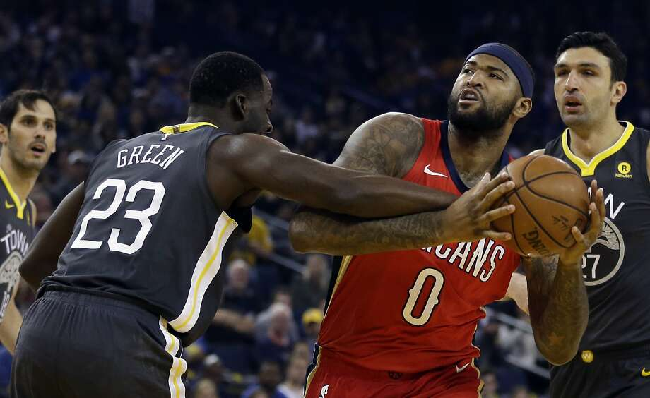 Golden State Warriors' Draymond Green, left, defends against New Orleans Pelicans center DeMarcus Cousins (0) during the first half of an NBA basketball game Saturday, Nov. 25, 2017, in Oakland, Calif. (AP Photo/Ben Margot) Photo: Ben Margot, Associated Press