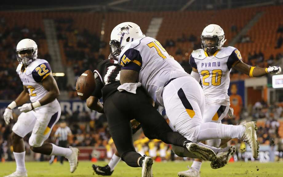 Prairie View A&M Panthers defensive lineman James Harper (75) hits Texas Southern Tigers quarterback Elijah Odom (10) forcing a fumble in the second half during the NCAA football game between the Prairie View A&M Panthers and the Texas Southern Tigers at BBVA Compass Stadium in Houston, TX on Saturday, November 25, 2017.  The Panthers defeated the Tigers 30-16. Photo: Tim Warner/For The Chronicle