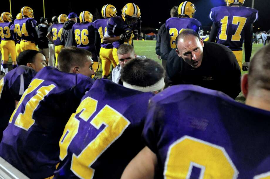 Troy's line coach Jim Canfield, right, talks strategy with his linemen in the Class AA Super Bowl football game against Shenendehowa on Friday, Nov. 5, 2010, at Colonie High in Colonie, N.Y. (Cindy Schultz / Times Union) Photo: Cindy Schultz / 00010884A