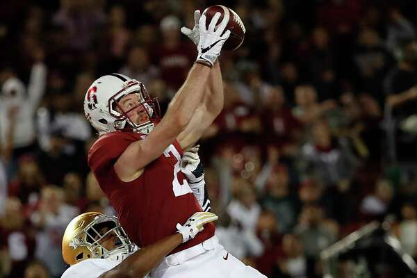 Stanford wide receiver Trenton Irwin (2) catches a touchdown pass in front of Notre Dame cornerback Troy Pride Jr. (18) during the first half of an NCAA college football game Saturday, Nov. 25, 2017, in Stanford, Calif. (AP Photo/Tony Avelar) ORG XMIT: CATA103