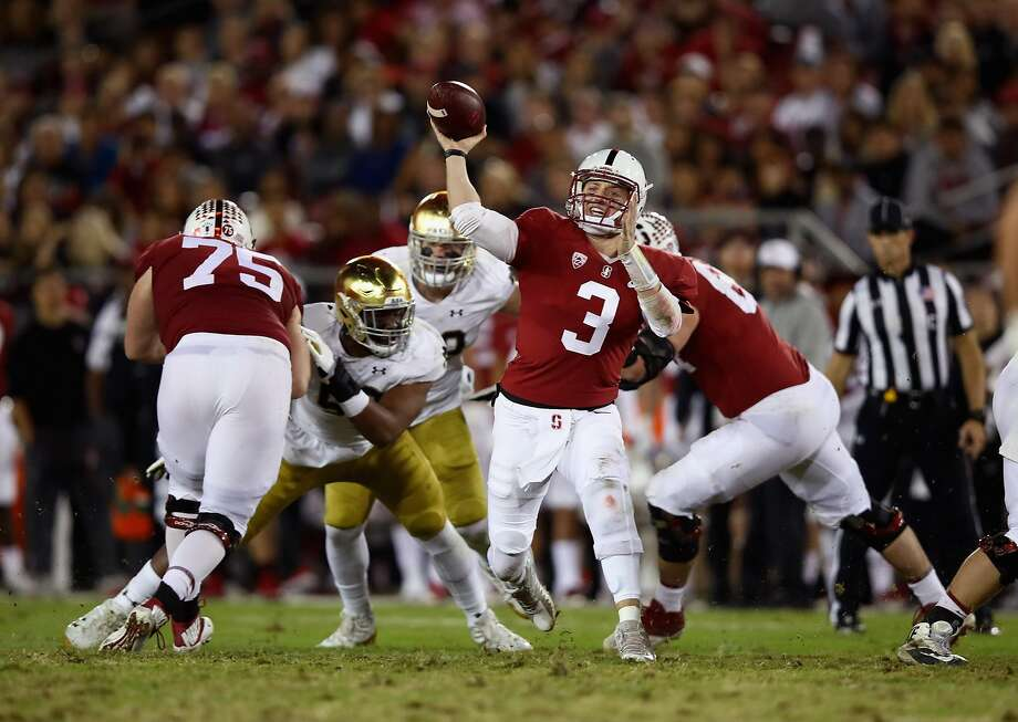 K.J. Costello #3 of the Stanford Cardinal passes the ball against the Notre Dame Fighting Irish at Stanford Stadium. Photo: Ezra Shaw, Getty Images