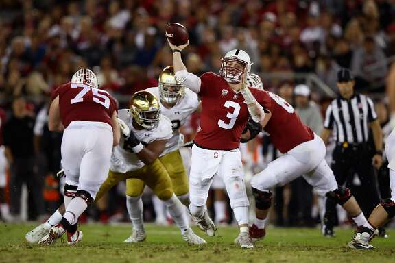 PALO ALTO, CA - NOVEMBER 25:  K.J. Costello #3 of the Stanford Cardinal passes the ball against the Notre Dame Fighting Irish at Stanford Stadium on November 25, 2017 in Palo Alto, California.  (Photo by Ezra Shaw/Getty Images)