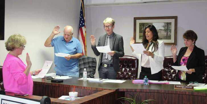 Members of Splendora City Council and Mayor Dorothy Welch are sworn in during the Nov. 20 city council meeting. Left to right are City Secretary Danna Welter, Aldermen David Aden, Aton DuLaney, Evelyn Meyers and Mayor Welch.