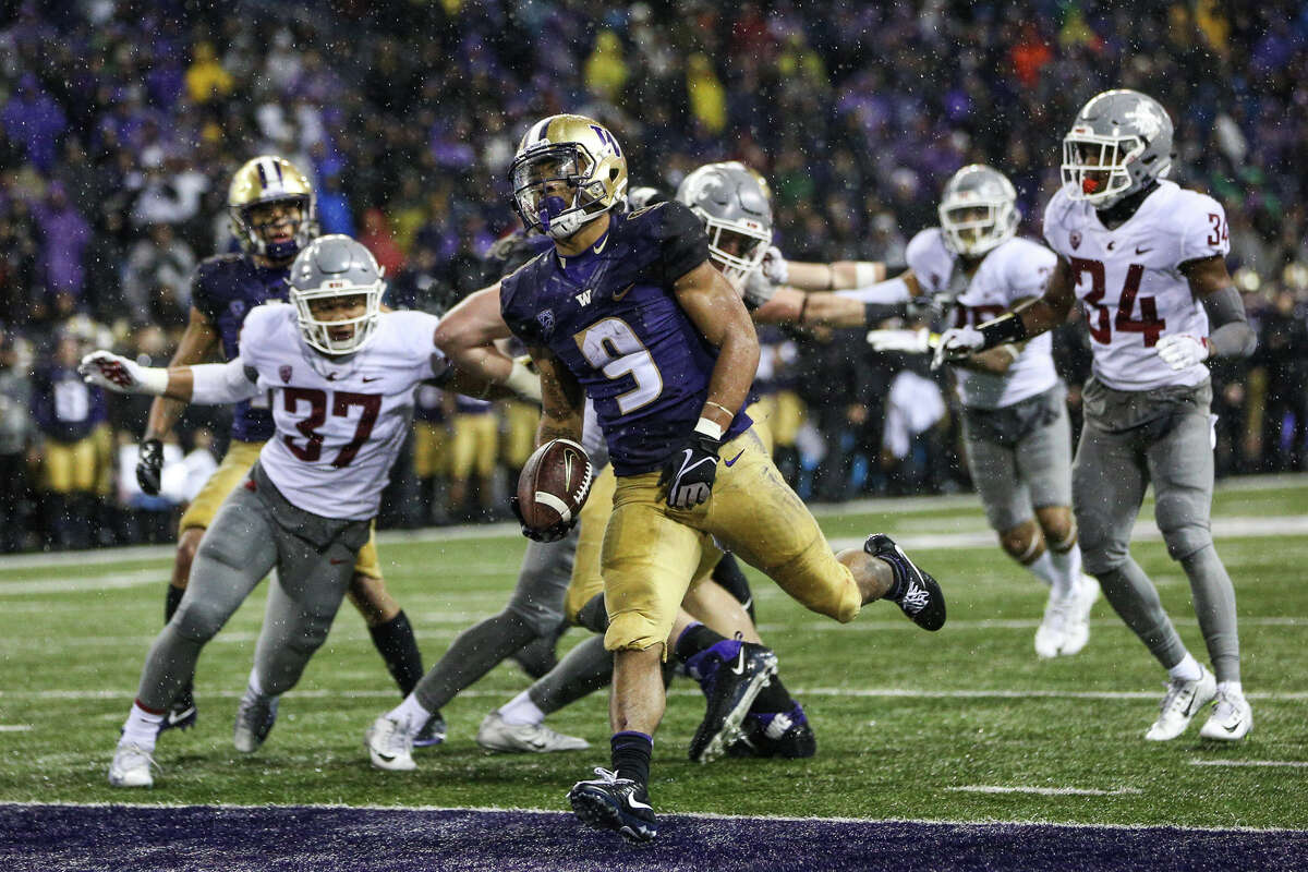 Washington tailback Myles Gaskin scores a touchdown during the second half of the Apple Cup at Husky Stadium on Saturday, Nov. 25, 2017.