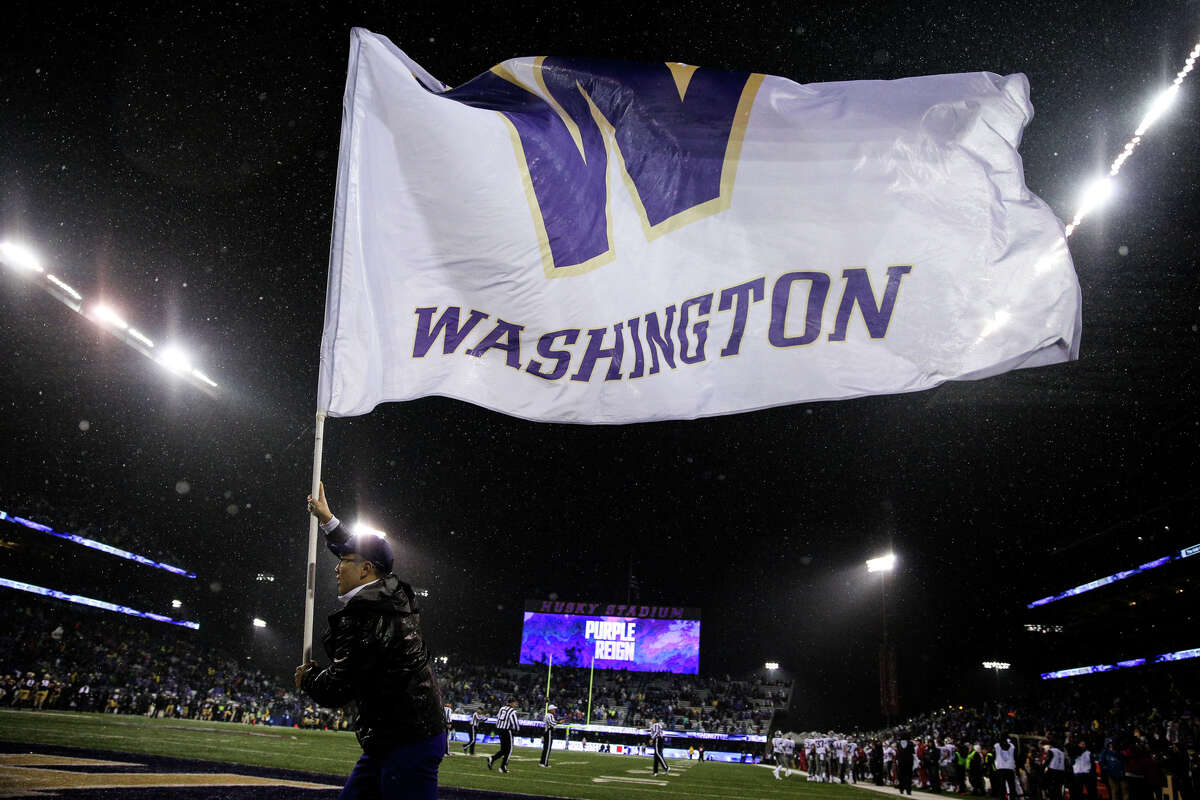 Washington's flag is flown following a touchdown during the second half of the Apple Cup at Husky Stadium on Saturday, Nov. 25, 2017.
